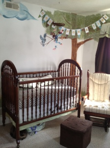 "Close up of the crib. Props to Auntie Em and her fabulous library card banner that reads ""Once Upon a Time."" She made it for our book-themed baby shower--another post to come as soon as I have pics!"