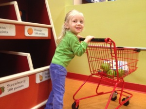 Playing in her favorite exhibit at the Children's Museum...the grocery store!